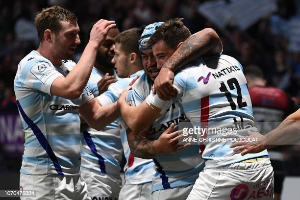 Racing 92's French centre Olivier Klemenczak celebrates with teammates after scoring a try during the European Rugby Champions Cup union match...