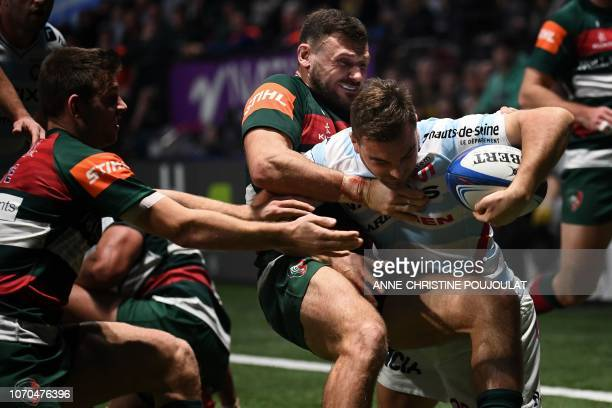 Racing 92's French centre Olivier Klemenczak runs to score a try against Leicester's English wing Adam Thompstone during the European Rugby Champions...