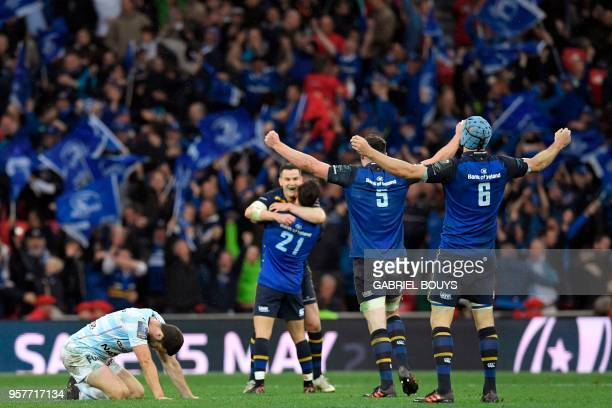 Racing 92's French flyhalf Remi Tales reacts as Leinster's players celebrate after the 2018 European Champions Cup final rugby union match between...