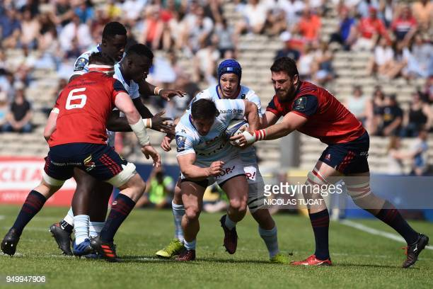 Racing 92's French hooker Camille Chat runs to evade Munster's South African lock Jean Kleyn during the European Champions Cup semifinal rugby union...