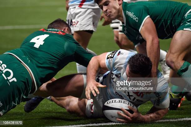Racing 92's French hooker Camille Chat scores a try during the French Top 14 rugby union match between Racing92 and Pau on October 27 2018 at the U...