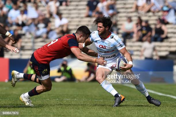 Racing 92's French scrumhalf Maxime Machenaud is tackled By Munster's Irish scrumhalf Conor Murray during the European Champions Cup semifinal rugby...