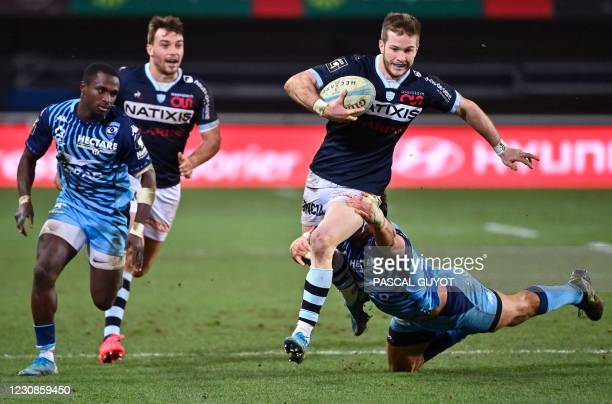 Racing 92's French wing Louis Dupichot runs with the ball during the French Top 14 rugby union match between Montpellier and Racing 92 on January 29...