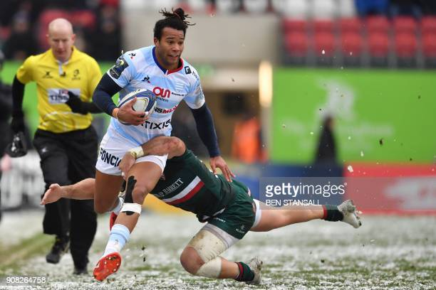 Racing 92's French wing Teddy Thomas is tackled by Leicester Tigers' Welsh centre Gareth Owen during the European Champions Cup Pool 4 rugby union...