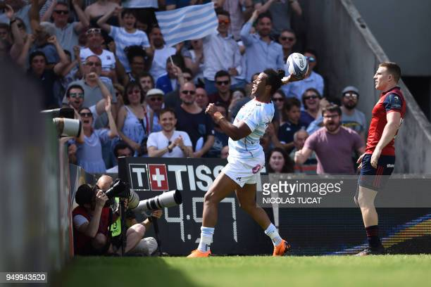 Racing 92's French winger Teddy Thomas celebrates after scoring a try during the European Champions Cup semifinal rugby union match between Racing 92...
