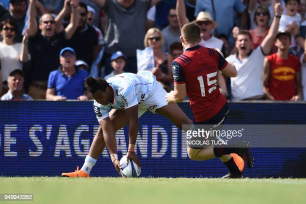Racing 92's French winger Teddy Thomas scores a try during the European Champions Cup semifinal rugby union match between Racing 92 and Munster on...