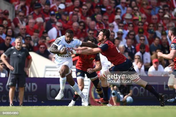 TOPSHOT Racing 92's French winger Virimi Vakatawa runs to evade Munster's South African lock Jean Kleyn during the European Champions Cup semifinal...