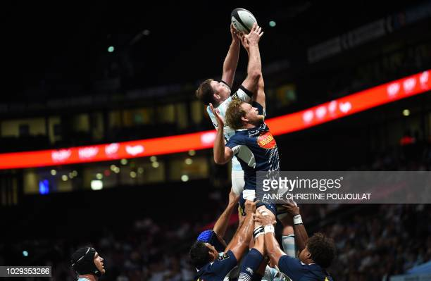 Racing 92's Irish flanker Donnacha Ryan and Agen's Australian lock Tom Murday jump for the ball during the French Top 14 rugby union match between...