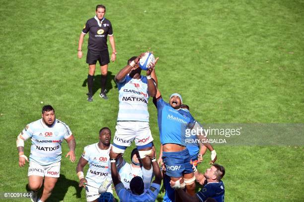 Racing 92's lock Leone Nakarawa grabs the ball in a line out next to Castres' flanker Alex Bias during the French Top 14 rugby union match between...