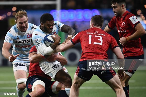 Racing 92's New Zealand-born French centre Virimi Vakatawa vies with Munster's Irish centre Chris Farrell during the European Champions Cup rugby...