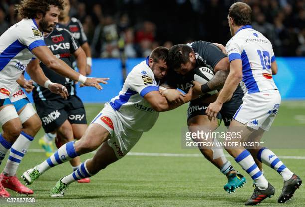Racing 92's New Zealander prop Benjamin Tameifuna collapses with Castres' French prop Tudor Stroe during the French Top 14 rugby union match between...