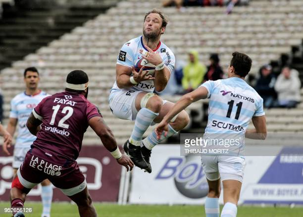 TOPSHOT Racing 92's number eight Antonie Claassen catches a high ball as teammate Argentinian winger Juan Imhoff and BordeauxBegles Fijian centre...