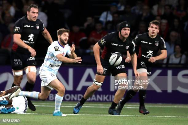 Racing 92's Teddy Iribaren passes the ball during the Top 14 Rugby match between Racing 92 and Stade toulousain at the U Arena Stadium in Nanterre on...