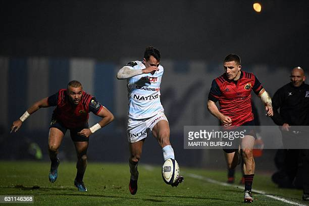 Racing 92's winger Juan Jose Imhoff tries to avoid the tackle of Munster Rugby's winger Andrew Conway as Munster Rugby's fullback Simon Zebo looks on...