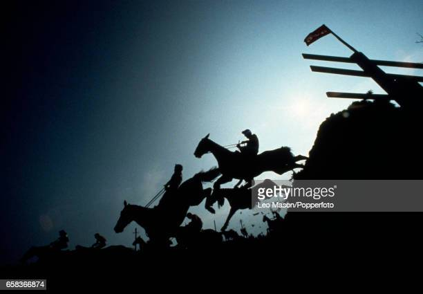 Racing action in silhouette during the Grand National at Aintree Racecourse near Liverpool England on 31st March 1979