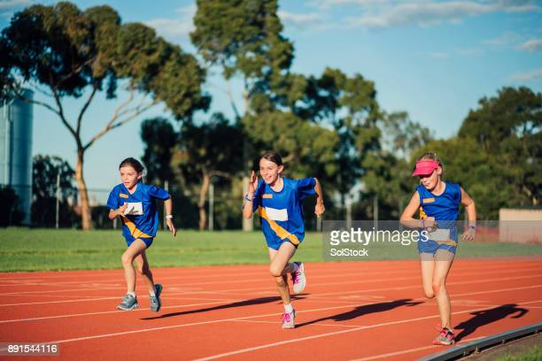 racing at athletics club - athletics stock photos and pictures