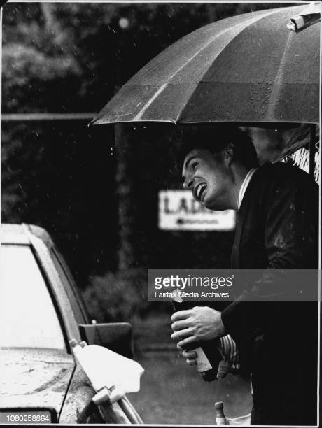 Racing at FlemingtonIn the car park more rain and more champagne for Peter Griffiths down from Sydney November 02 1992