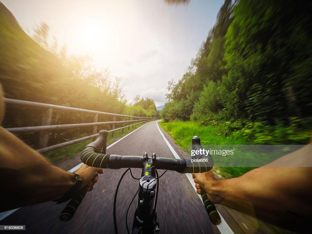 Racing bicycle POV riding : Stock Photo