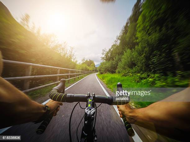 racing bicycle pov riding - racing bicycle stock pictures, royalty-free photos & images