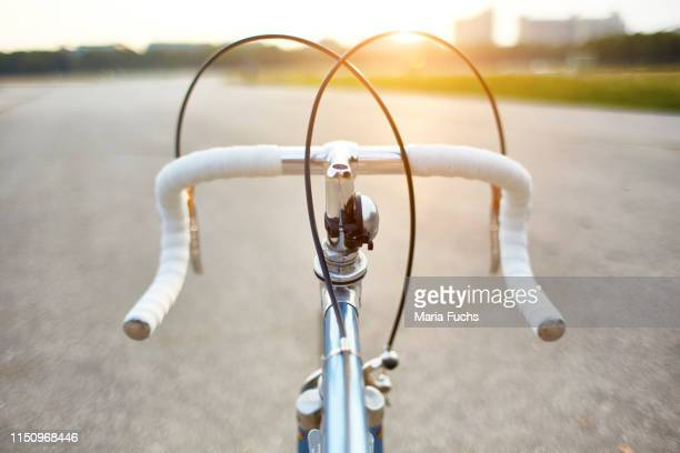racing bike on rural road, personal perspective view of handlebars - handlebar stock pictures, royalty-free photos & images
