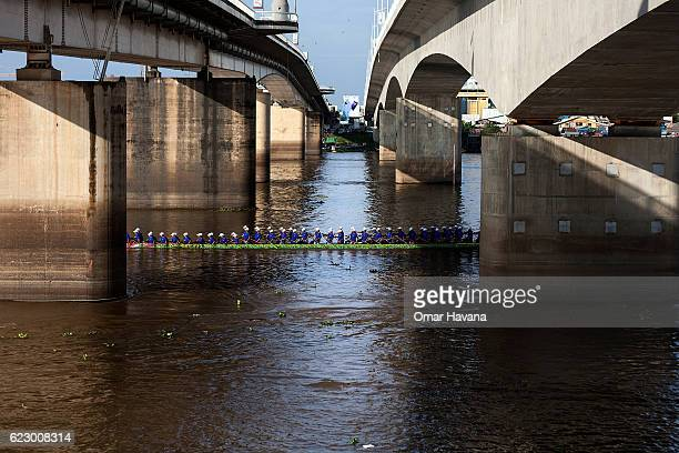 A racing boat passes under the Japanese Bridge during their training on the waters of the Tonle Sap River on the morning of the first day of the...