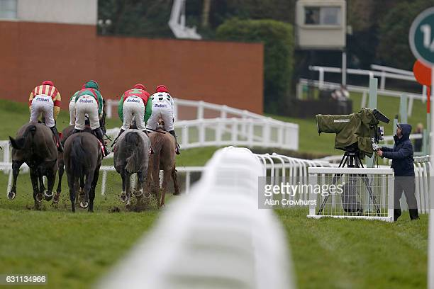 Racing camerman films the action during The 32Red Tolworth Novices' Hurdle Race at Sandown Park on January 7 2017 in Esher England