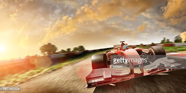 racing car at speed in summer sunset - grand prix motor racing stock pictures, royalty-free photos & images