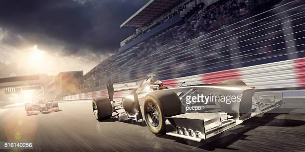 racing car during race on track at sunset - motorsport stock pictures, royalty-free photos & images
