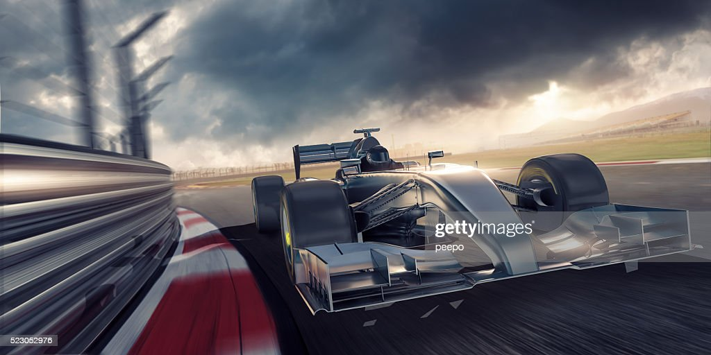 Racing Car During Race on Track At Sunset : Stock Photo