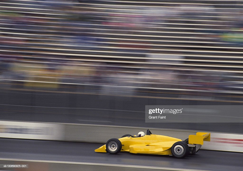 Racing car on track (blurred motion) : Stockfoto
