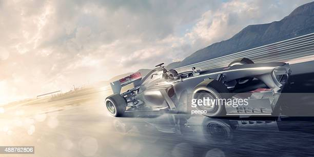 Racing Car Speeding Past on Wet Racetrack At Sunset