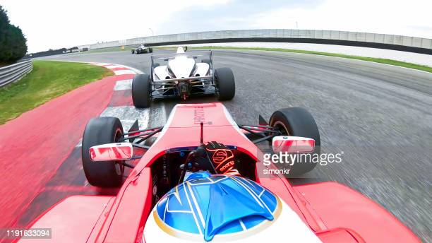 racing cars driving on track - motorsport stock pictures, royalty-free photos & images