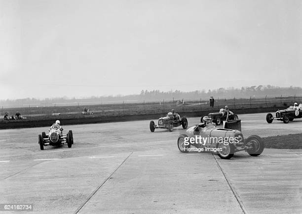 Racing cars taking a corner at Brooklands Surrey c1930s Artist Bill BrunellERA Event Entry No 2 Left Alta Entry No 6 Left of centre Unidentified car...
