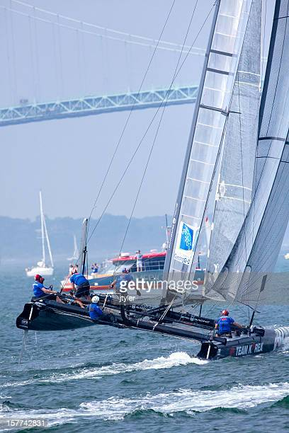 racing  catamaran yacht in a  balancing maneuve - catamaran stock photos and pictures