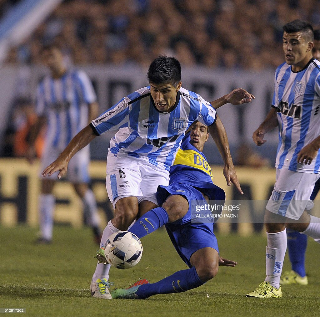 Racing Club defender Luciano Lollo (front) vies for the ball with Boca Juniors defender Nahuel Molina (back) during their Argentina First Division football match at Presidente Peron stadium in Avellaneda, Buenos Aires, on February 28, 2016.