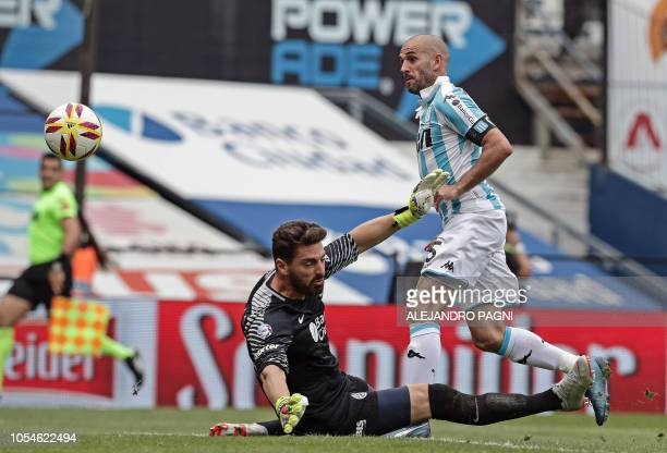 Racing Club's forward Lisandro Lopez shots the ball to score against San Lorenzo during their Argentina First Division Superliga football match at...