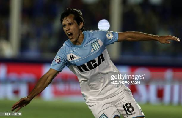 Racing Club's midfielder Augusto Solari celebrates after scoring a goal against Tigre during their Argentina First Division Superliga football match...