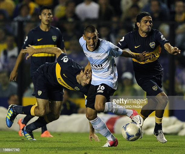 Racing Club's midfielder Ricardo Centurion vies for the ball with Boca Juniors' midfielder Walter Erviti during their Argentine First Division...