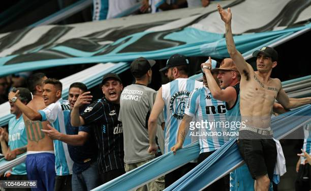 Racing Club's supporters cheer for their team during their Argentina First Division Superliga football match against San Lorenzo at Presidente Peron...