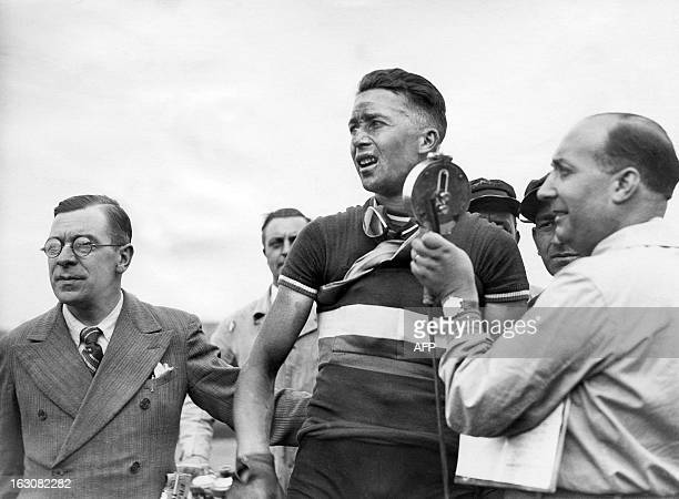 Racing cyclist Jean Majerus of Luxembourg is interviewed after winning the 1st stage ParisLille of the Tour de France on June 30 1937