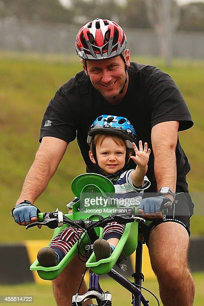 A racing cyclist with his son rides during Below the Belt Pedalthon where teams ride for up to 4 hours to defeat 4 different cancers at Sydney...