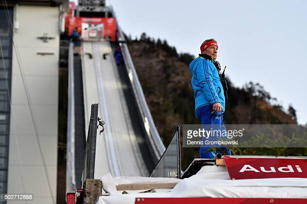 FIS racing director Walter Hofer inspects the jumping hill after competition was stopped due to a blackout on Day 1 of the 64th Four Hills Tournament...