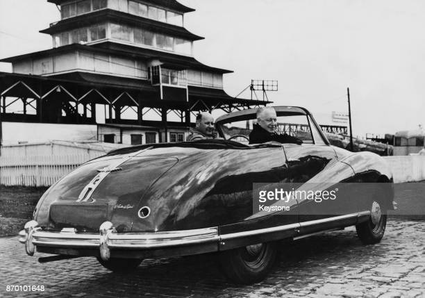 Racing driver Alan Hess takes Arthur H Marlow the British Consul General at Chicago for a ride in the highspeed Austin Atlantic at the Indianapolis...