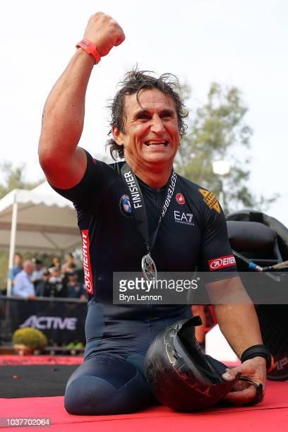 Racing Driver Alessandro Zanardi of Italy celebrates finishing IRONMAN Emilia Romagna on September 21 2018 in Cervia Italy