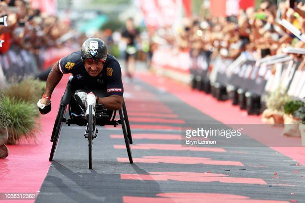 Racing driver Alessandro Zanardi of Italy crosses the finishline to complete IRONMAN Emilia Romagna on September 21 2018 in Cervia Italy