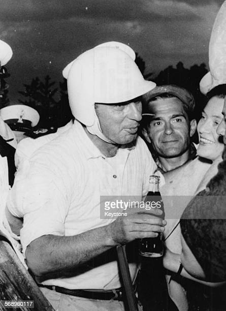 Racing driver Alfonso Thiele with a Coca Cola in his hand after winning Monza Grand Prix in his Ferrari car June 28th 1959