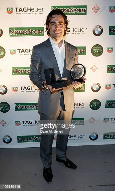Racing driver and hall of fame inductee Dario Franchitti poses at the Motor Sport Hall of Fame 2011 in association with TAG Heuer celebrating and...