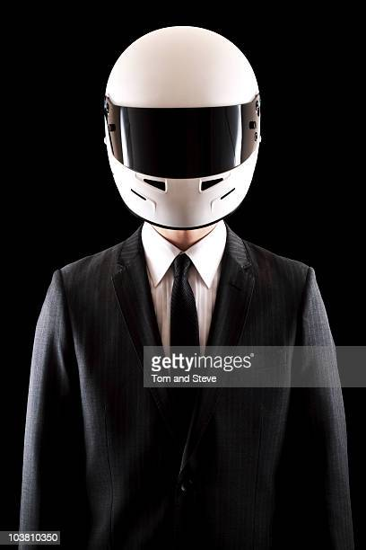 racing driver businessman in pinstripe suit straig - sports helmet stock pictures, royalty-free photos & images