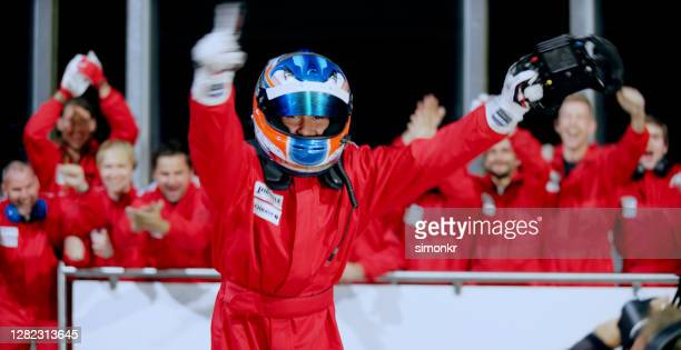 racing driver celebrating his victory - racing driver stock pictures, royalty-free photos & images