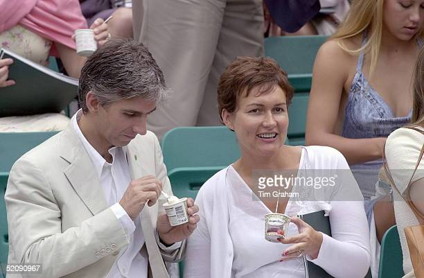 Racing Driver Damon Hill And Wife Georgie Eating Icecream At A Charity Tennis Tournament On Behalf Of The Nspcc.